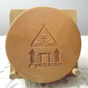 4 Leather Scouts Canada Coasters on Wooden Stand